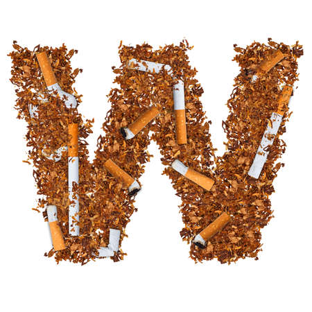 Letter W made of cigarettes and dried smoking tobacco  photo