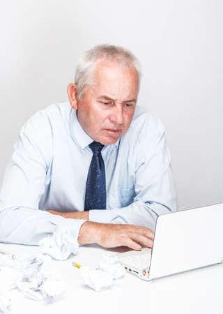 Senior businessman working with laptop photo