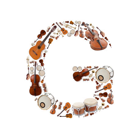 Musical instruments alphabet on white background  Letter G photo