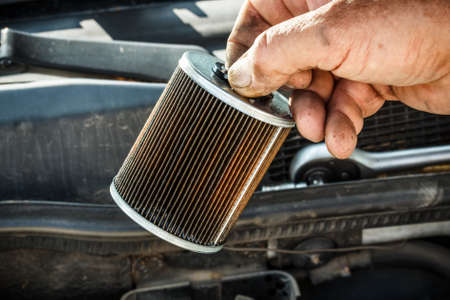 lubrication: Car mechanic replace the fuel filter