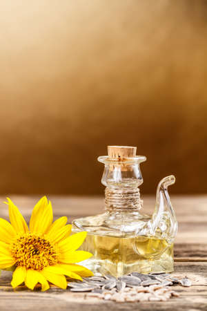 oilcan: Oilcan of sunflower oil with sunflower seeds and sunflower