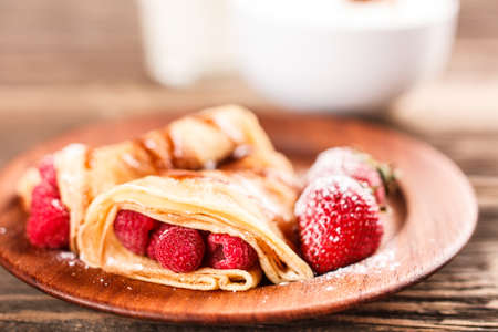 Pancake with fruits and powdered sugar