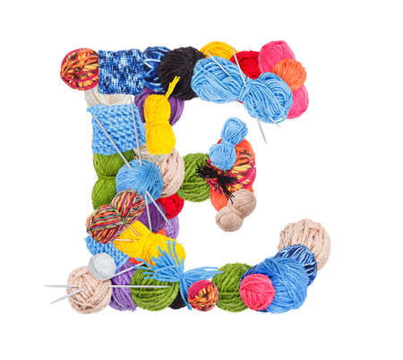 Letter E made of knitting yarn isolated on white background photo