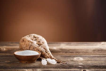White sugar in wood bowl