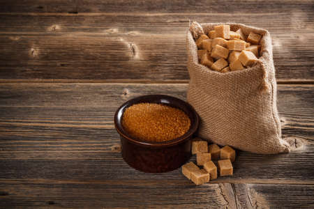Brown cane sugar cubes in burlap sack photo