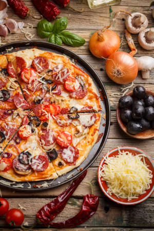 Top view of tasty pizza in metal plate photo