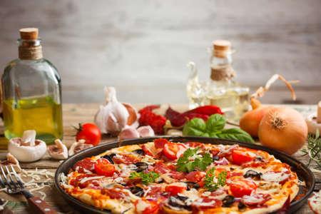 italian cuisine: Still life of fresh homemade pizza
