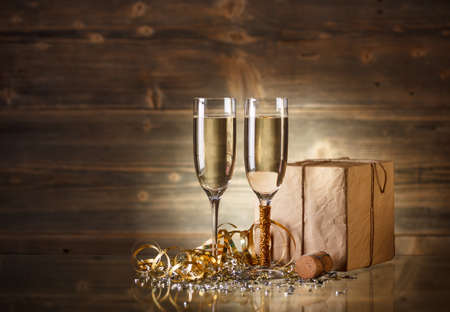 New Year and Christmas Celebration, two champagne glasses and gift photo