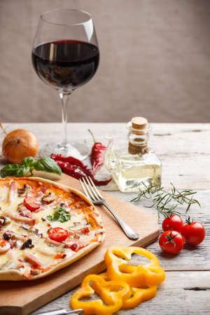 Pizza with ham and cherry tomato  photo