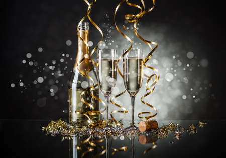 Glasses of champagne and bottle with festive background Stock Photo