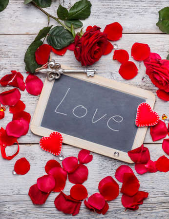Romantic text handwritten on blackboard with chalk, valentines day  Stock Photo - 25212879