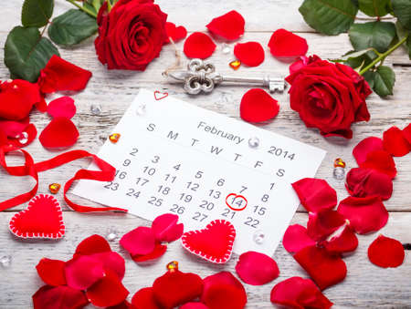 Calendar page with hearts, petals and ribbon on St.Valentines Day photo