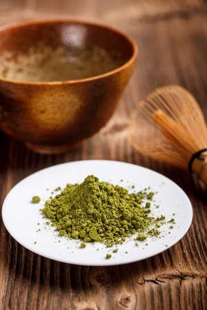 maccha: Matcha tea powder on white plate Stock Photo