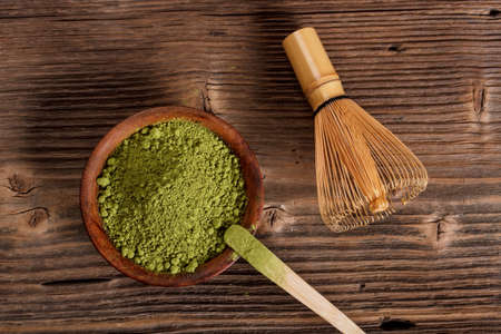 Powdered green matcha tea with bamboo whisk