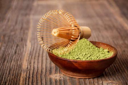 maccha: Green powder matcha tea with bamboo whisk