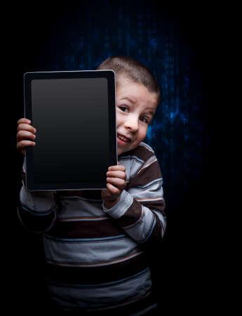 keek: Cute kid with tablet, keek Stock Photo
