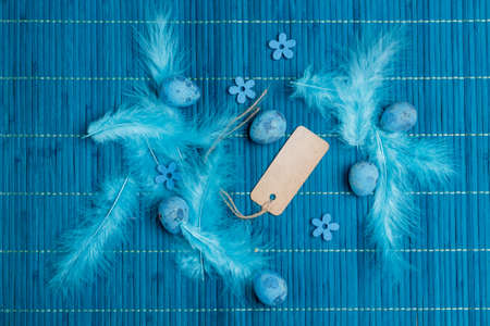 easter background: Easter background with Easter eggs and blue feather Stock Photo