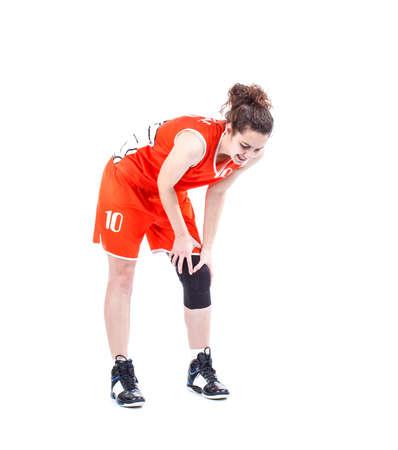 膝の痛みの女性のバスケット ボール選手 写真素材