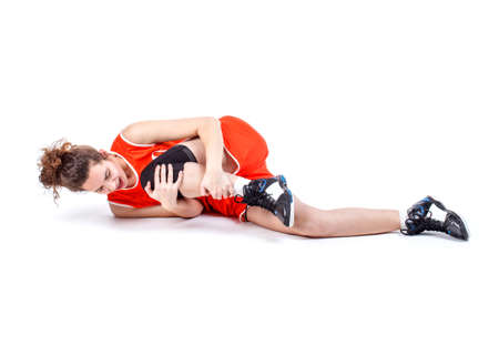 therapeutical: Basketball player in medical bandage, knee support