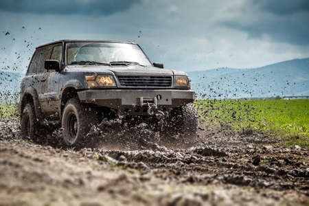 Off road vehicle splashed mud  Stock Photo