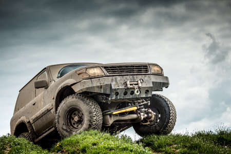 Very muddy off road car Banque d'images