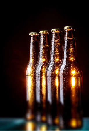 The group of wet bottles of beer