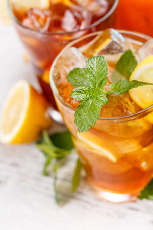 iced tea: Mint leaf and lime slice on the top of iced tea Stock Photo