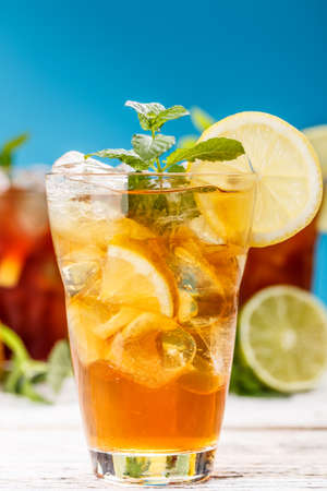 Fresh and cold ice tea decorated with mint leaf photo
