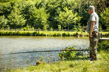 Man fishing on a lake  photo
