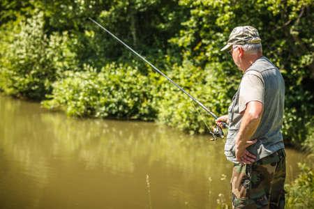 Fisherman fishing in a lake  photo