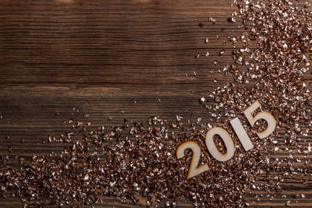 suface: Wooden numbers forming 2015 on a rustic wooden suface