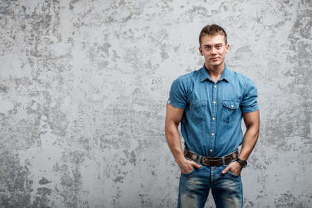 Handsome young man in jeans photo