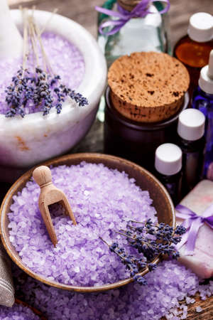 Dried lavender flowers with a bottle of essential oil photo