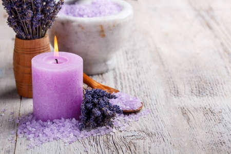 wooden aromatherapy: Aromatherapy concept, candle with lavender flowers Stock Photo