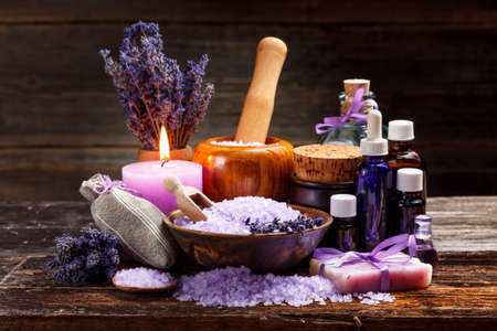 Lavender bath items on wooden background Imagens
