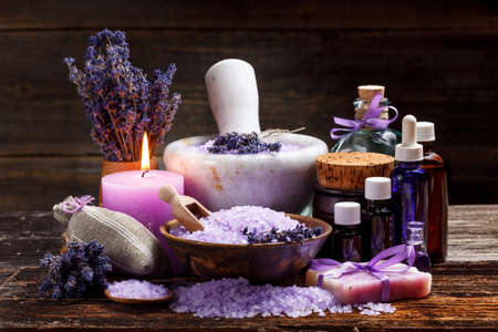 Still life with lavender candle, soap, salt and dried lavender