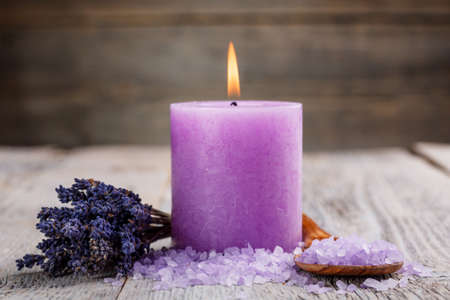 Spa setting with candle, salt and dried flower