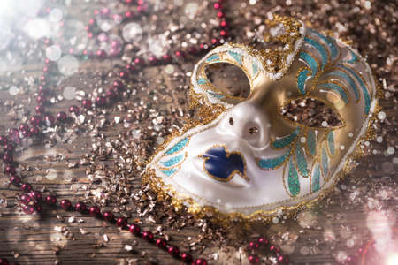carnivale: Carnival mask with red necklace and golden confetti