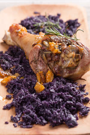 drumstick: Roasted turkey drumstick with braised red cabbage Stock Photo