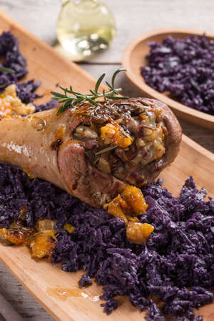 red braised: Roasted turkey drumstick with braised red cabbage Stock Photo