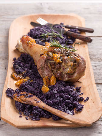 red braised: Roasted turkey drumstick served with braised red cabbage Stock Photo