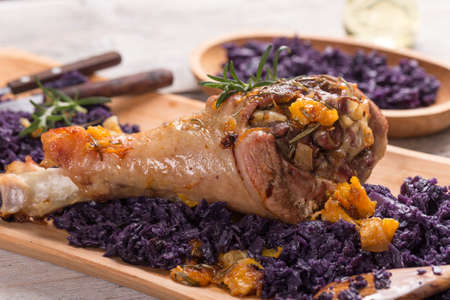 red braised: Close up of roasted turkey drumstick with braised red cabbage