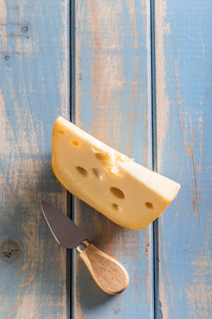 emmental: Emmental cheese piece with cheese knife Stock Photo