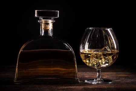 cognac: Cognac or brandy on wooden table
