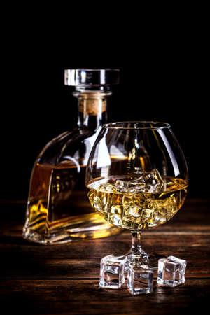 cognac: Vintage cognac still life on wooden table