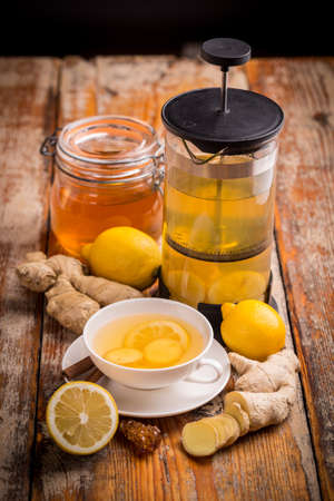 Still life of ginger tea on wooden board photo