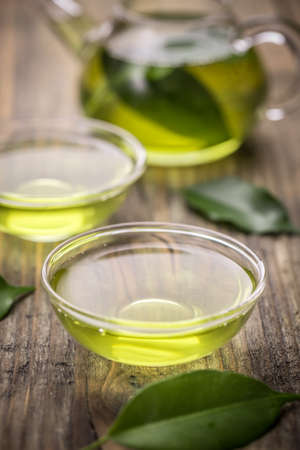 green tea cup: Healthy green tea cup with tea leaves