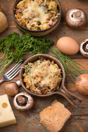 Bread souffle in dish with cheese, mushroom and ham