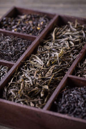 wooden crate: Assortment of dry tea in wooden crate