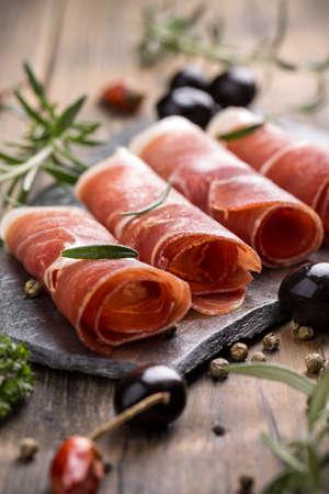 cured ham: Pork collar ham on flagstone, rustic style Stock Photo